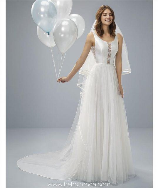 a5fef73412 Oliviana  La sofisticación del mikado Kelly se funde con la magia y el  romanticismo del tul en este espectacular vestido de novia de corte  princesa que ...